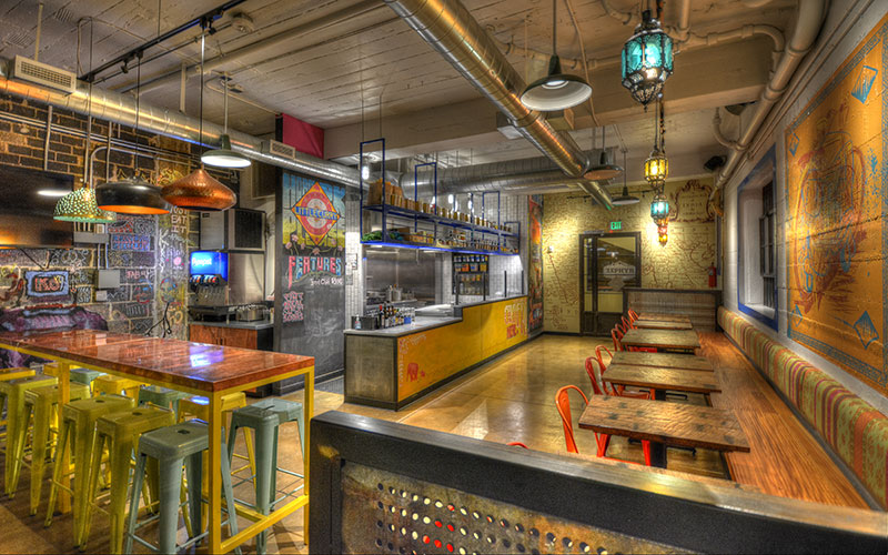 Interior design photo of Biju's Little Curry Shop located in downtown restaurant custom design metalwork wood interior design recycled Shike Denver Colorado Denver, Colorado designed by Shike Design.